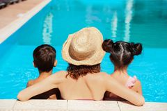 Woman with children in swimming pool. At resort royalty free stock photography