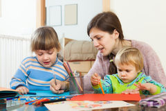 Woman and  children together drawing with pencils Stock Photo