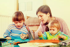 Woman and  children together drawing with pencils Stock Photography
