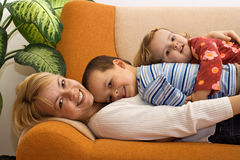 Woman and children together at home Royalty Free Stock Photo