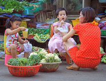 Woman with childrens on street market in Hue, Vietnam Stock Images