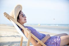 Woman chilling on the beach Stock Photography
