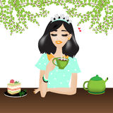Woman is chilling and drinking coffee.There is a cake and green kettle on the table Royalty Free Stock Images
