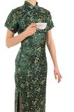 Woman in Chinese dress with a cup of tea Stock Image