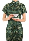 Woman in Chinese dress holding a cup of tea Royalty Free Stock Photography