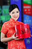 Woman in a chinese dress receiving a gift Royalty Free Stock Photography