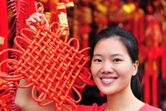Woman with chinese knot Stock Photos