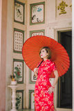 Woman chinese qipao Stock Images