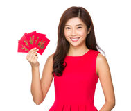 Woman and chinese red pocket Royalty Free Stock Photography