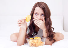 Woman with chips Stock Image