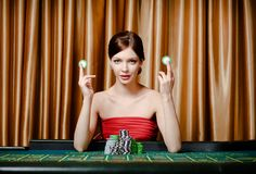 Woman with chips at the casino table royalty free stock photography
