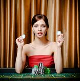 Woman with chips at the playing table Stock Photography