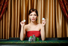 Woman with chips at the roulette table Stock Photography