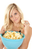 Woman with chips smiling Stock Photos