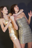 Woman chocking another girl Stock Images