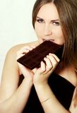 Woman and chocolate Royalty Free Stock Images