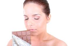 Woman with chocolate Stock Images