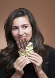 Woman with chocolate Royalty Free Stock Photography