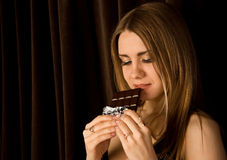 Woman and chocolate Royalty Free Stock Photos