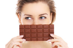Woman and chocolate Stock Images