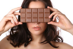 Woman with chocolate. Attractive woman covers her face with chocolate isolated on white Royalty Free Stock Photos