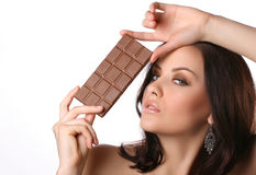 Woman with chocolate. On white Royalty Free Stock Photos