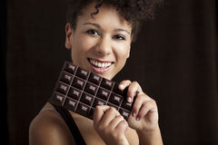 Woman with a chocolate bar Royalty Free Stock Images