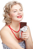 Woman with chocolate bar Stock Images