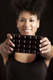 Woman with a chocolate bar Stock Photography