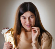 Woman with with a chocolate bar Royalty Free Stock Photo