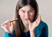 Woman with with a chocolate bar Stock Image
