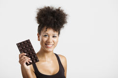 Woman with a chocolate bar royalty free stock photography