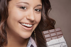 Woman with chocolate bar Royalty Free Stock Images