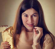 Woman with  a chocolate bar Stock Images