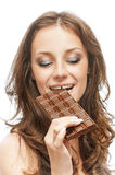 Woman with chocolate bar Royalty Free Stock Image