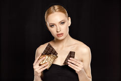 Woman with chocolate bars Royalty Free Stock Images