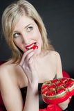 Woman with chocolate box Royalty Free Stock Photography