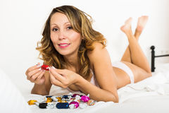 Woman with chocolate candy resting Royalty Free Stock Photos