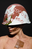Woman with chocolate helmet, camouflage looks away Royalty Free Stock Images