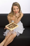 Woman with chocolates Royalty Free Stock Photography