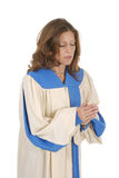 Woman In Choir Robe Praying royalty free stock images