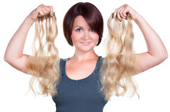 Woman choose her extensions. Woman choose the right extensions Royalty Free Stock Photography