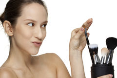 Woman choose the make up brush Stock Photos