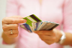 Woman choose one credit card from many, concept of  credit card. Debt Royalty Free Stock Image