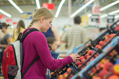 Woman choose red apples in supermarket Stock Photo