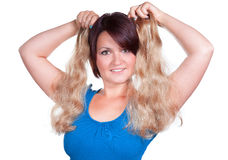 Woman choose the right color for extensions. Woman choose the right extensions Stock Photos