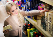 Woman choose soap in shop. Young girl choose some soap in the shop Stock Image