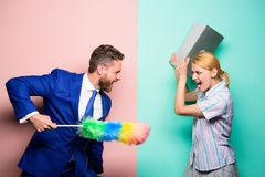 Woman choose to work digital technology. Man force girl to clean up. Gender inequality start from household. Gender. Discrimination. Gender inequality concept royalty free stock image