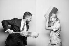 Woman choose to work digital technology. Man force girl to clean up. Gender inequality start from household. Gender stock photography