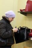 Woman chooses bag Royalty Free Stock Image